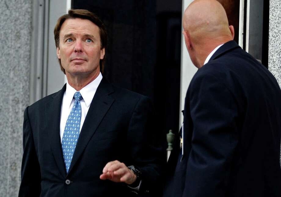 FILE - In this May 8, 2012 file photo, former presidential candidate and Sen. John Edwards, left, leaves a federal courthouse in Greensboro, N.C. Lawyers for Edwards are set to begin presenting his defense at the former presidential contender?s conspiracy and campaign-finance trial on Monday, May 14, 2012. (AP Photo/Chuck Burton, File) Photo: Chuck Burton / Copyright 2012 The Associated Press. All rights reserved. This material may not be published, broadcast, rewritten or redistribu