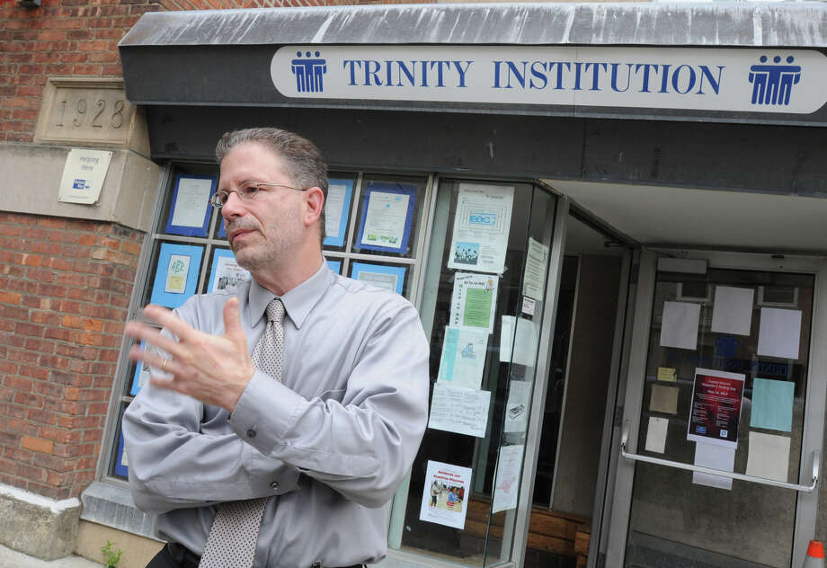 Harris Oberlander, CEO of Trinity Alliance and head of SNUG, talks about the recent shootings in Albany while standing outside the Trinity Alliance headquarters Monday, May 14, 2012 in Albany, N.Y. (Lori Van Buren / Times Union) Photo: Lori Van Buren
