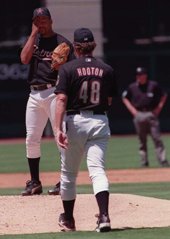 Houston Astros pitcher Jose Lima wipes sweat from his forehead as pitching coach Burt Hooton approaches the pitching mound in a game against the St. Louis Cardinals in which Lima allowed eight hits and nine runs, including three homers at Enron Field in Houston, Texas APRIL 21, 2001. Photo: D. Fahleson / Houston Chronicle
