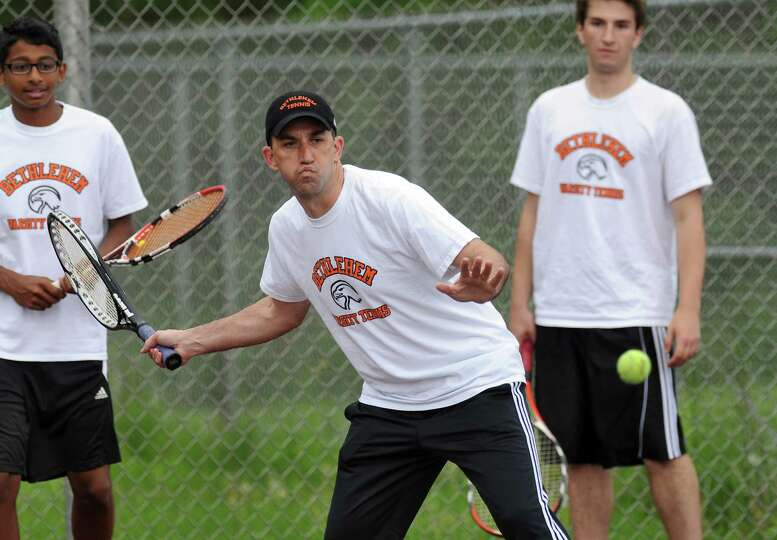 Bethlehem High School boys tennis coach Stephen Smith practices with his team as they awaited their