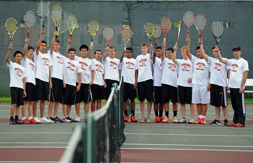 Members of the Bethlehem High School boys tennis team, including head coach Stephen Smith, far right
