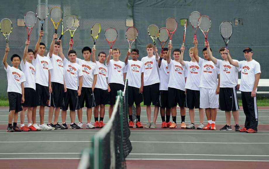 Members of the Bethlehem High School boys tennis team, including head coach Stephen Smith, far right, awaited their opening opponent in the Section II tournament as they practiced at the school on Monday May 14, 2012 in Delmar, NY.  (Philip Kamrass / Times Union ) Photo: Philip Kamrass / 00017663A