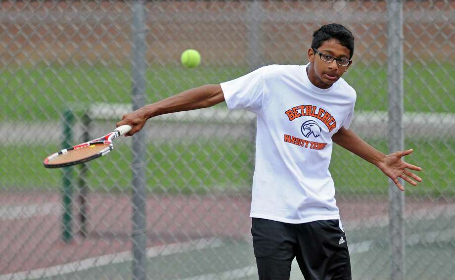 Bethlehem High School boys tennis player Rohin Bose practices as he and teammates awaited their opening round opponent in the Section II tournament, at the school on Monday May 14, 2012 in Delmar, NY.  (Philip Kamrass / Times Union ) Photo: Philip Kamrass / 00017663A