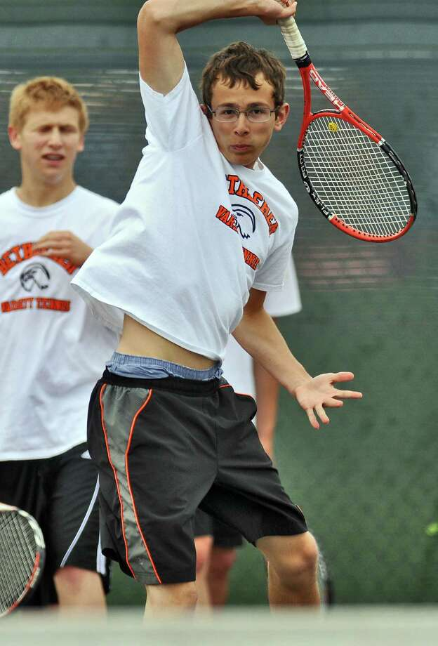 Bethlehem High School boys tennis player Nick Mashuta practices as he and teammates awaited their opening round opponent in the Section II tournament, at the school on Monday May 14, 2012 in Delmar, NY.  (Philip Kamrass / Times Union ) Photo: Philip Kamrass / 00017663A