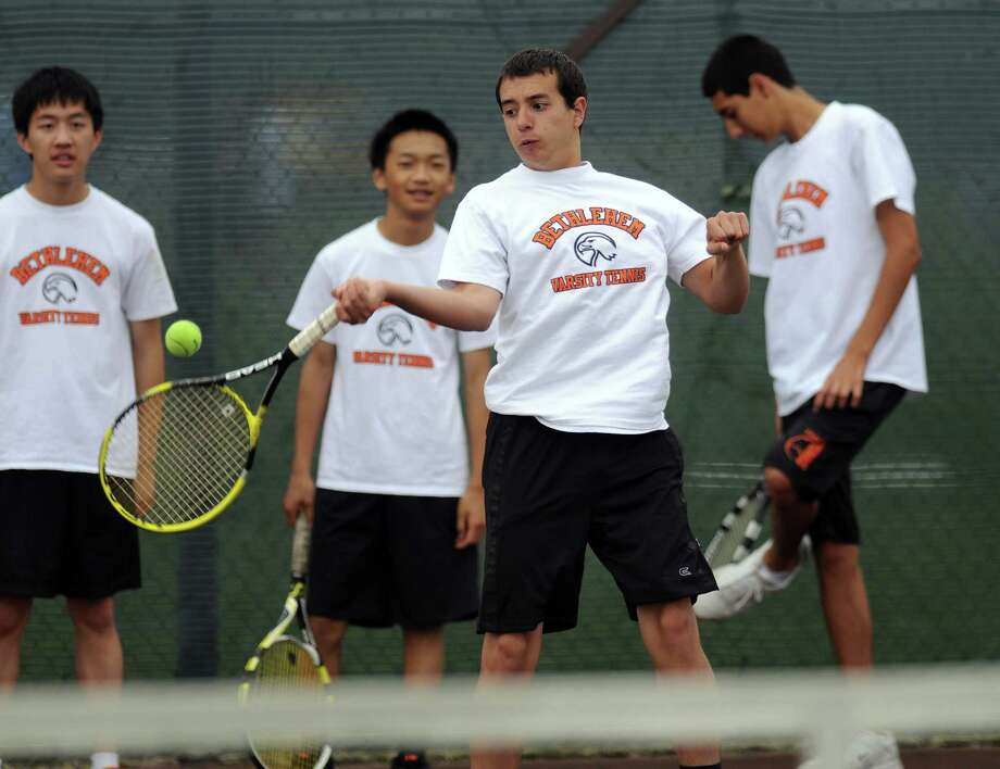 Bethlehem High School boys tennis player Nick DeLuke practices as he and teammates awaited their opening round opponent in the Section II tournament, at the school on Monday May 14, 2012 in Delmar, NY.  (Philip Kamrass / Times Union ) Photo: Philip Kamrass / 00017663A