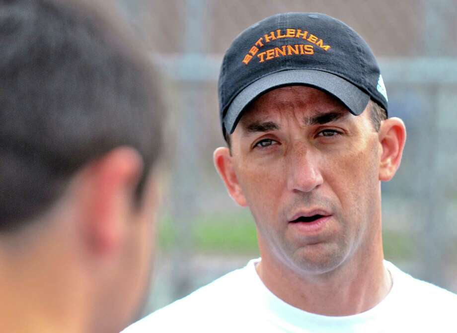 Bethlehem High School boys tennis coach Stephen Smith talks to his players during practice as they awaited their opening round opponent in the Section II tournament, at the school on Monday May 14, 2012 in Delmar, NY.  (Philip Kamrass / Times Union ) Photo: Philip Kamrass / 00017663A
