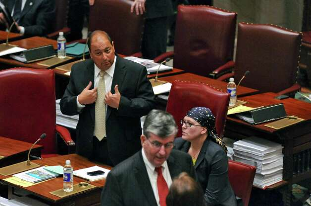 State Senator Tom Libous, Deputy Majority Leader, left, speaks on the floor of the Senate chamber to say that the senate was in for a long night considering bills, on Wednesday, March 14, 2012 in Albany, N.Y. State Senator Neil D. Breslin, Deputy Minority Leader, is in the foreground. (Philip Kamrass / Times Union) Photo: Philip Kamrass