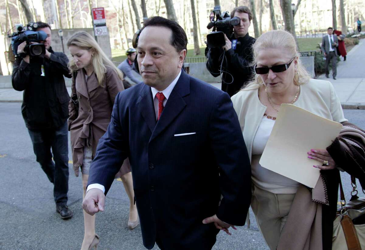 Pedro Espada, Jr. arrives to court with his wife Connie Espada in New York, Wednesday, March 14, 2012. Former state senator Pedro Espada Jr. is facing embezzlement charges involving his health care clinics in a federal trial. (AP Photo/Seth Wenig)