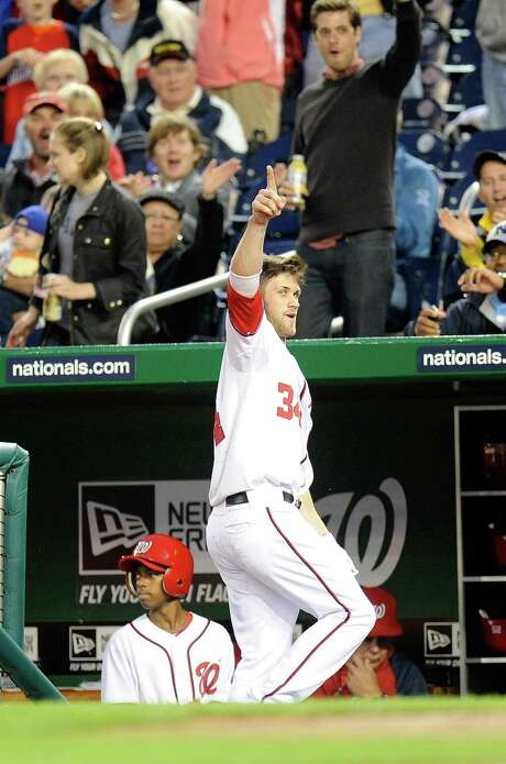 Nationals rookie Bryce Harper takes a curtain call for fans after hitting his first career home run in the third inning of Monday's game against San Diego. Photo: Greg Fiume / 2012 Getty Images