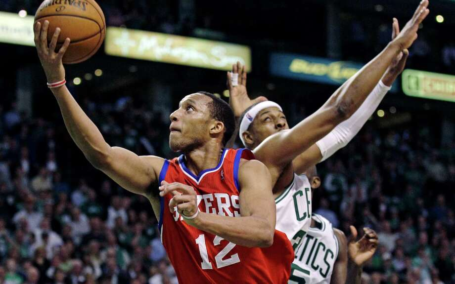Philadelphia's Evan Turner (12) gets past Paul Pierce for the go-ahead bucket with 40.4 seconds left. Photo: Charles Krupa / AP