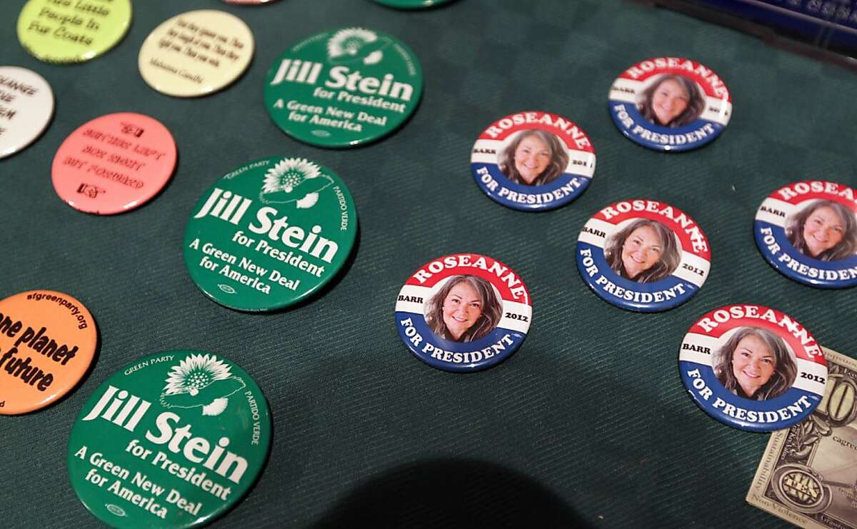 Jill Stein and Roseanne Barr pins were on sale at the Green Party debate Saturday, May 12, 2012.