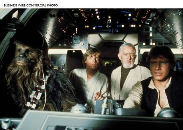 Chewbacca, Luke Skywalker (Mark Hamill), Ben (Obi-Wan) Kenobi (Alec Guinness), and Han Solo (Harrison Ford) in the Millennium Falcon.
