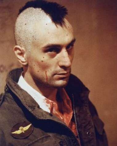 "De Niro as troubled loner Travis Bickle in Scorsese's 1976 ""Taxi Driver."""