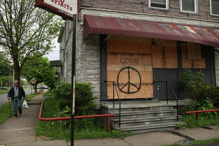 UTICA, NY - MAY 14:  A closed business sits boarded-up on May 14, 2012 in Utica, New York. Like many upstate New York communities, Utica is struggling to make the transition from a former manufacturing hub. The city's individual poverty rate is twice the national average with an unemployment rate of 9.8% as of February 2012. Citing Utica's weakening financial margins over the past two years, Fitch Ratings downgraded its credit rating on Utica by two notches to a triple-B, two rungs above junk territory. Photo: Spencer Platt, Getty Images / 2012 Getty Images