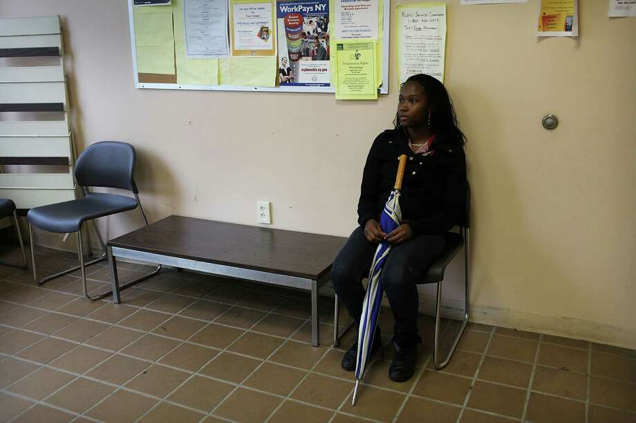 UTICA, NY - MAY 14: Shandola Williams waits in an employment office on May 14, 2012 in Utica, New York. Like many upstate New York communities, Utica is struggling to make the transition from a former manufacturing hub. The city's individual poverty rate is twice the national average with an unemployment rate of 9.8% as of February 2012. Citing Utica's weakening financial margins over the past two years, Fitch Ratings downgraded its credit rating on Utica by two notches to a triple-B, two rungs above junk territory. Photo: Spencer Platt, Getty Images / 2012 Getty Images