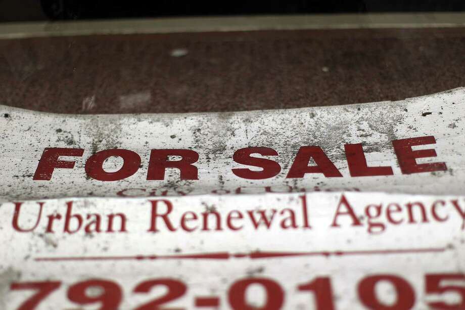 "UTICA, NY - MAY 14:  A ""for sale"" sign hangs in a window of an empty building on May 14, 2012 in Utica, New York. Like many upstate New York communities, Utica is struggling to make the transition from a former manufacturing hub. The city's individual poverty rate is twice the national average with an unemployment rate of 9.8% as of February 2012. Citing Utica's weakening financial margins over the past two years, Fitch Ratings downgraded its credit rating on Utica by two notches to a triple-B, two rungs above junk territory. Photo: Spencer Platt, Getty Images / 2012 Getty Images"