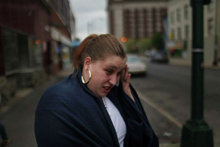 UTICA, NY - MAY 14: Amanda Kessler, who is currently unemployed, speaks about a difficult job search on May 14, 2012 in Utica, New York. Like many upstate New York communities, Utica is struggling to make the transition from a former manufacturing hub. The city's individual poverty rate is twice the national average with an unemployment rate of 9.8% as of February 2012. Citing Utica's weakening financial margins over the past two years, Fitch Ratings downgraded its credit rating on Utica by two notches to a triple-B, two rungs above junk territory. Photo: Spencer Platt, Getty Images / 2012 Getty Images