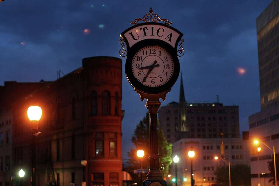 UTICA, NY - MAY 14: A clock stands in downtown Utica on May 14, 2012 in Utica, New York. Like many upstate New York communities, Utica is struggling to make the transition from a former manufacturing hub. The city's individual poverty rate is twice the national average with an unemployment rate of 9.8% as of February 2012. Citing Utica's weakening financial margins over the past two years, Fitch Ratings downgraded its credit rating on Utica by two notches to a triple-B, two rungs above junk territory. Photo: Spencer Platt, Getty Images / 2012 Getty Images