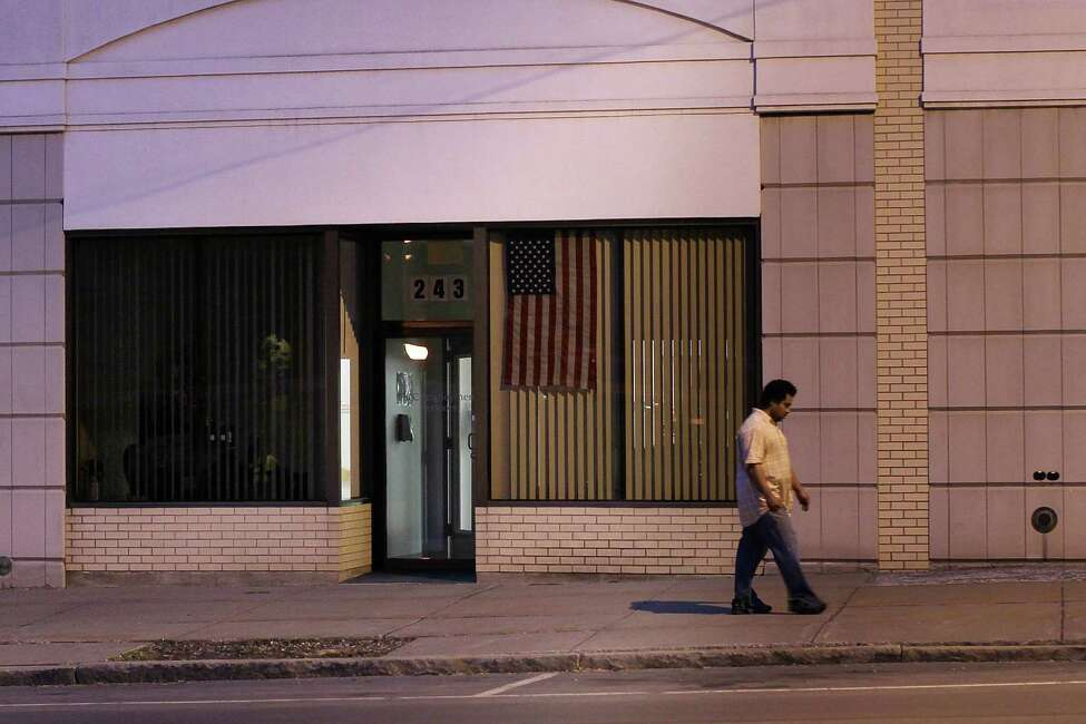UTICA, NY - MAY 14: A man walks down a street on May 14, 2012 in Utica, New York. Like many upstate New York communities, Utica is struggling to make the transition from a former manufacturing hub. The city's individual poverty rate is twice the national average with an unemployment rate of 9.8% as of February 2012. Citing Utica's weakening financial margins over the past two years, Fitch Ratings downgraded its credit rating on Utica by two notches to a triple-B, two rungs above junk territory.