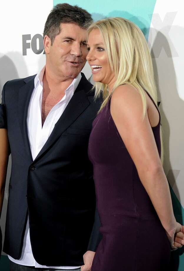 """The X Factor"" judges Simon Cowell and Britney Spears attend the FOX network upfront presentation party at Wollman Rink, Monday, May 14, 2012 in New York. Photo: Evan Agostini, AP / AGOEV"