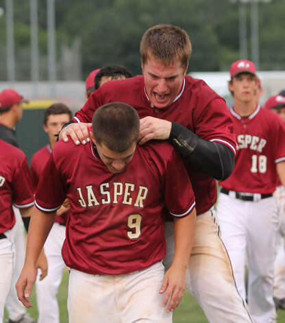 Joe Walker and Jacob Clark celebrate Saturday's win over Madisonville. Photo: Jason Dunn