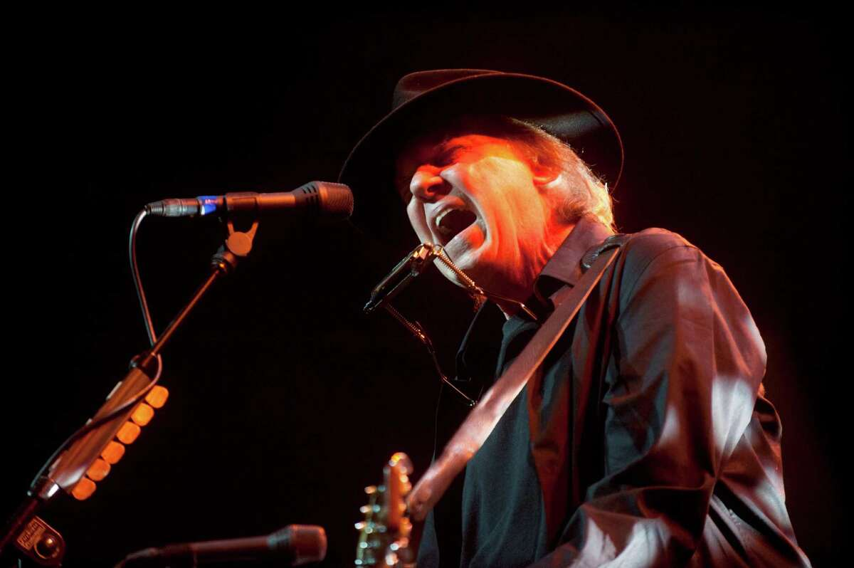 In this photo provided by Robin Hood, musician Neil Young performs onstage at the Robin Hood Annual Benefit, Monday, May 14, 2012, at the Javits Center in New York. Robin Hood funds programs that fight poverty in New York City.