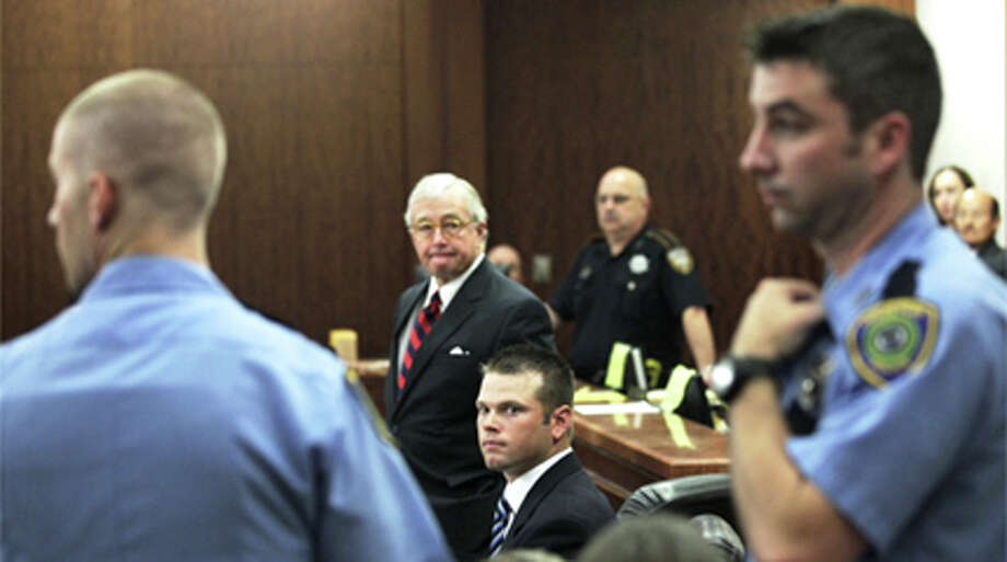 Defense attorney Dick DeGuerin stands next to his client, former Houston Police officer Andrew Blomberg, as a group of HPD officers are ordered from the courtroom Tuesday, May 15, 2012, in Houston. Blomberg is on trial for official oppression in the video taped 2010 beating of 15-year-old Chad Holley. Photo: .