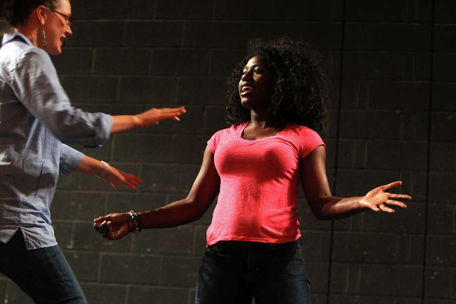 Kaitlin Hopkins coaches vocal scholarship candidate Kia Malone, a student at NSA, during the Las Casas Master Class at Empire Theatre, Saturday, May 7, 2012. (JENNIFER WHITNEY) Photo: JENNIFER WHITNEY, For The Express-News / special to the Express-News