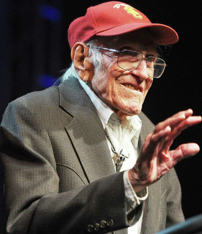 """Louis Zamperini, 1917-2014:The Olympic distance runner and World War II veteran survived 47 days on a raft in the Pacific after his bomber crashed, then endured two years in Japanese prison camps. He is the subject of Laura Hillenbrand's best-selling book """"Unbroken: A World War II Story of Survival, Resilience, and Redemption,"""" which was made into a movie directed by Angelina Jolie. He died July 2 at age 97. Photo: Noel Vasquez, Getty Images / 2011 Getty Images"""