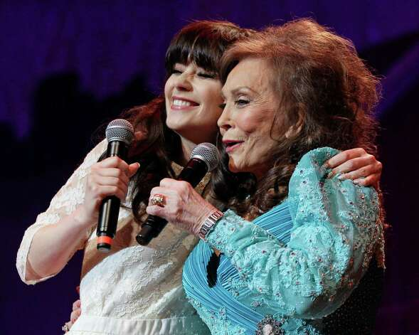 Country music star Loretta Lynn, right, and actress Zooey Deschanel sing Lynn's hit Photo: Mark Humphrey, Associated Press