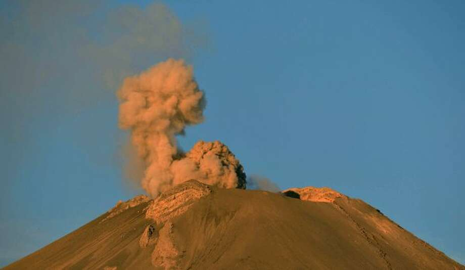 Ashes and smoke spew from the Popocatepetl Volcano in Paso de Cortes, in the Mexican central state of Puebla, on April 28, 2012. The volcano, Mexico's second highest peak at 5,452 metres, started rumbling and spurting high clouds of ash and steam on April 13, provoking the authorities to raise the alert to level five on a seven-point scale.   AFP PHOTO/Yuri CORTEZ        (Photo credit should read YURI CORTEZ/AFP/GettyImages) (AFP/Getty Images)