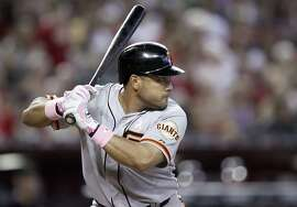 San Francisco Giants' Melky Cabrera bats against the Arizona Diamondbacks in the third inning of a baseball game Sunday, May 13, 2012, in Phoenix. Cabrera went four-for-four in the game as the Giants won 7-3.(AP Photo/Paul Connors)