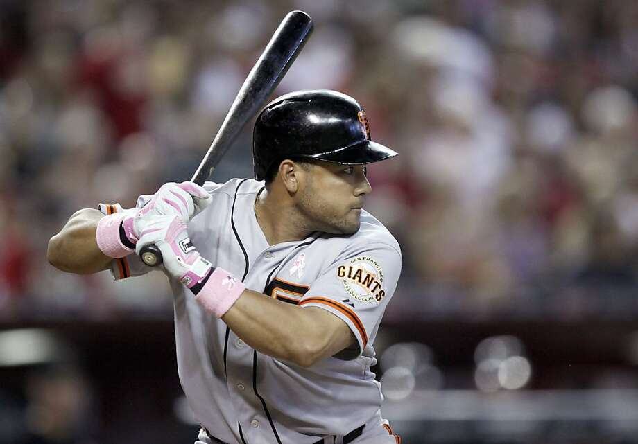 San Francisco Giants' Melky Cabrera bats against the Arizona Diamondbacks in the third inning of a baseball game Sunday, May 13, 2012, in Phoenix. Cabrera went four-for-four in the game as the Giants won 7-3.(AP Photo/Paul Connors) Photo: Paul Connors, Associated Press