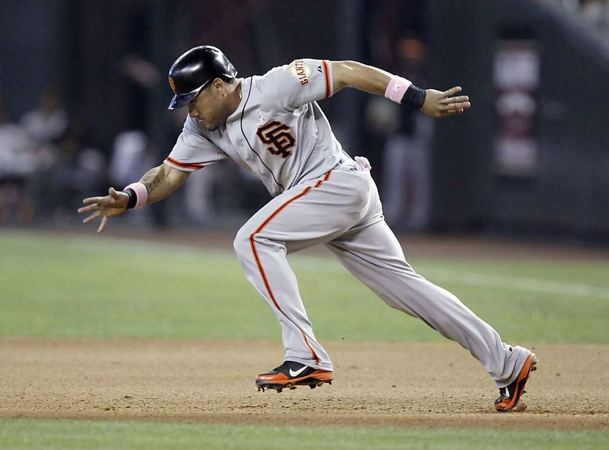 San Francisco Giants' Melky Cabrera takes off for second base against the Arizona Diamondbacks in the seventh inning of a baseball game Sunday, May 13, 2012, in Phoenix. Cabrera went four-for-four in the game as the Giants won 7-3.(AP Photo/Paul Connors)