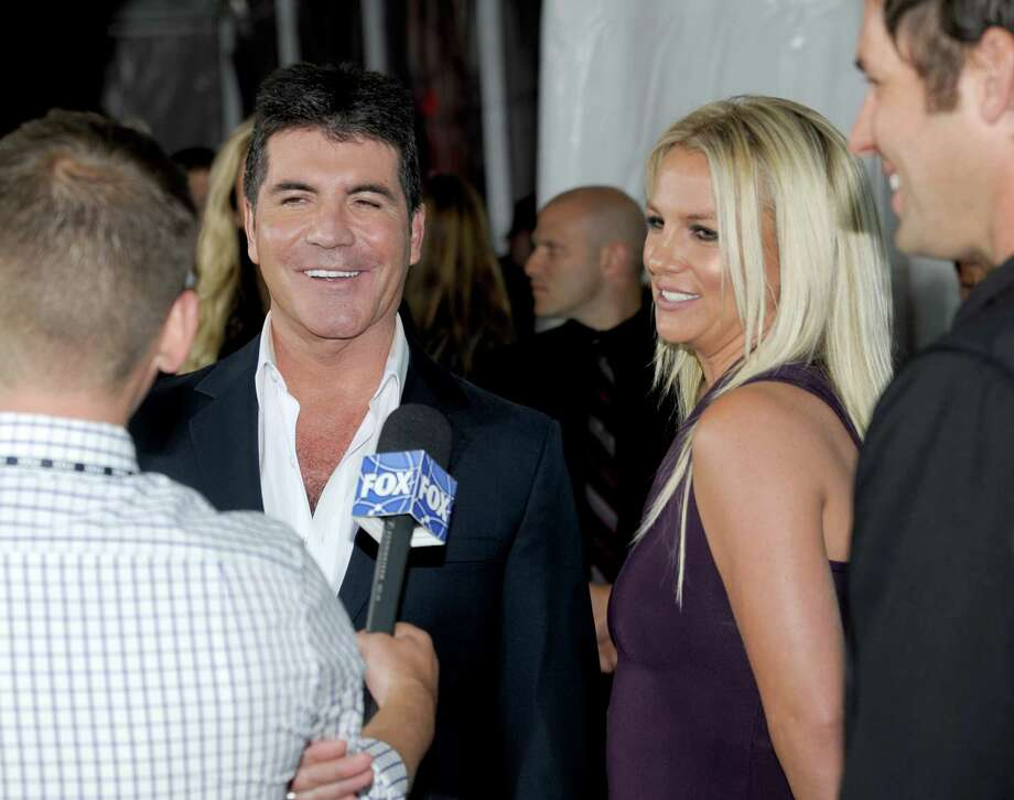 Simon Cowell and Britney Spears attend the Fox 2012 Programming Presentation Post-Show Party at Wollman Rink - Central Park on May 14, 2012 in New York City. Photo: Dave Kotinsky, Getty Images / 2012 Getty Images