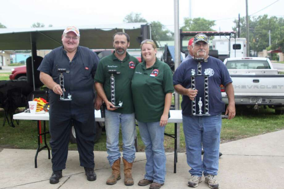 The winning teams from the Kountze Volunteer Fire Department Bar-b-que Cook-Off, Ribs Division, were (from left) Lumberton Fire & EMS, 3rd Place; Sour Lake VFD, 2nd Place; Kountze VFD J.U.G.G.'s Team, 1st Place. Photo: David Lisenby, HCN_Rib Winners