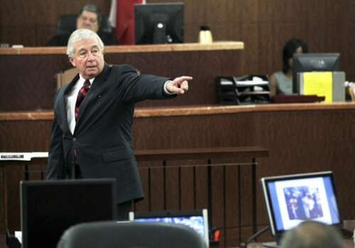 Defense attorney Dick DeGuerin gives his closing argument during the trial against former Houston Police officer Andrew Blomberg, as they arrive to court Tuesday, May 15, 2012, in Houston. Blomberg is on trial for official oppression in the video taped 2010 beating of 15-year-old Chad Holley. ( Brett Coomer / Houston Chronicle )
