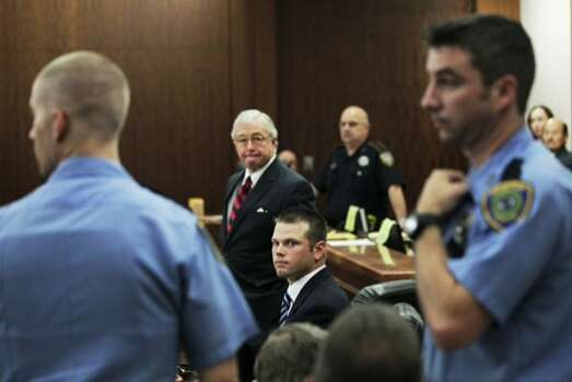 Defense attorney Dick DeGuerin stands next to his client, former Houston Police officer Andrew Blomberg, as a group of HPD officers are ordered from the courtroom Tuesday, May 15, 2012, in Houston. Blomberg is on trial for official oppression in the video taped 2010 beating of 15-year-old Chad Holley. ( Brett Coomer / Houston Chronicle )