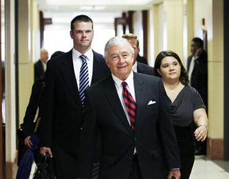 Defense attorney Dick DeGuerin walks with his client, former Houston Police officer Andrew Blomberg, left, as they arrive to court Tuesday, May 15, 2012, in Houston. Blomberg is on trial for official oppression in the video taped 2010 beating of 15-year-old Chad Holley. ( Brett Coomer / Houston Chronicle )