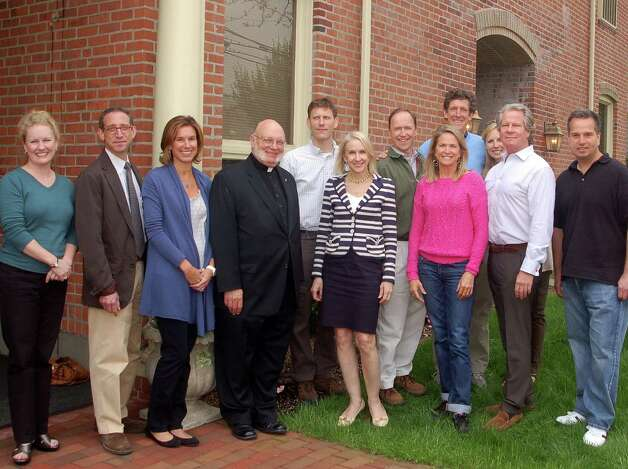 Pictured is Katherine Stanford of First Presbyterian, Carl Franco of Francos Wine Merchants, Lora Boniface, Msgr. Scheyd of St. Aloysius Church, Alex Stewart of Walter Stewarts, Diane Knetzger of The Bank of New Canaan, Steve Karl of Karl Chevrolet, Sharon Knechtle, Founder, PuraVida for Children, Cliffe Knechtle of Grace Church, PuraVida volunteer Christina Sachs, Dr. Greg Sanford and Joe Tantillo of Red Mango. Photo: Contributed Photo