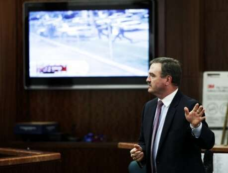 Prosecutor Clint Greenwood gives his closing argument during the trial of former Houston Police officer Andrew Blomberg Tuesday, May 15, 2012, in Houston. Blomberg is on trial for official oppression in the video taped 2010 beating of 15-year-old Chad Holley. ( Brett Coomer / Houston Chronicle )