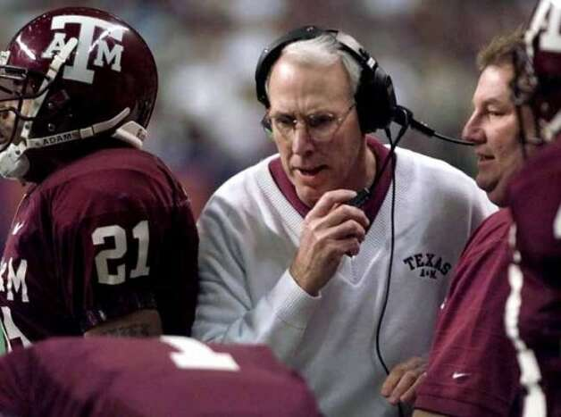 FILE--Texas A&M coach R. C. Slocum, center, talks to his players during the first quarter of the team's Alamo Bowl game against Penn State in  San Antonio, in this Dec. 28, 1999 photo. Notre Dame plays hosts to the Texas A&M Aggies in their season-opener on Saturday. (AP Photo/Eric Gay) (AP)