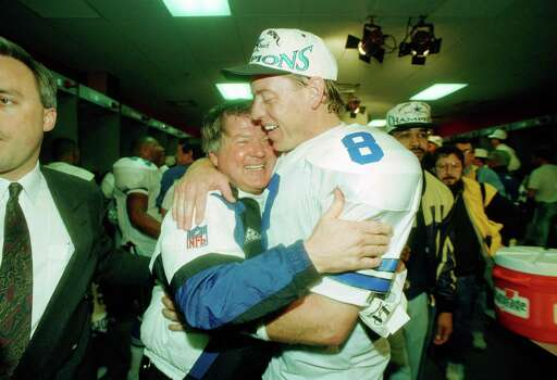 Dallas Cowboys' head coach Jimmy Johnson hugs quarterback Troy Aikman in their lockerroom after defeating the Buffalo Bills 30-13 in Super Bowl XXVIII at the Georgia Dome, Jan. 30, 1994.  The Cowboys handed the Bills their fourth straight Super Bowl defeat.  (AP Photo/Charles Krupa) Photo: Charles Krupa, STF / Beaumont