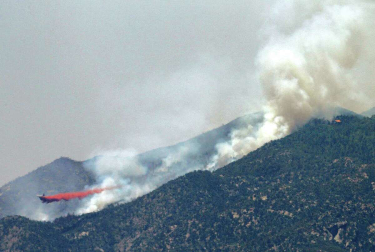 An air tanker drops retardant on a fire  near Crown King, Ariz. Fire crews spent the weekend fighting several wildfires in Arizona including the 4.5-square-mile blaze near Crown King.
