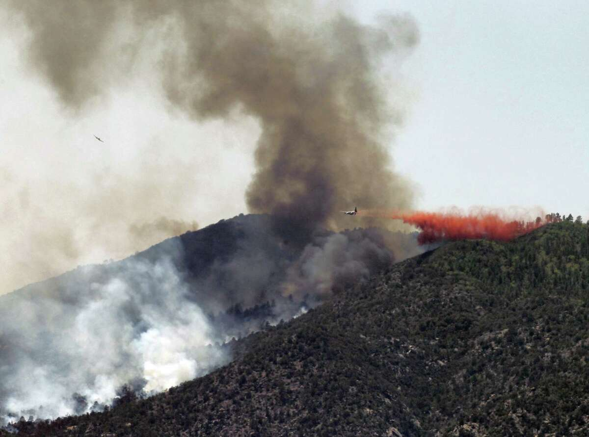 An air tanker drops retardant on a fire near Crown King, Ariz. Fire crews spent the weekend fighting several wildfires including the four and a half square mile blaze near Crown King.