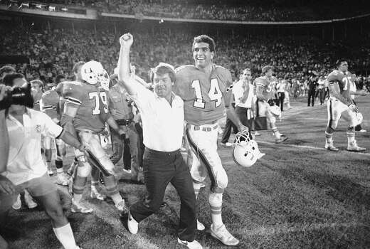 University of Miami football coach Jimmy Johnson leaves the field with quarterback Vinny Testaverde after the Hurricanes defeated Notre Dame, 58-7, Dec. 2, 1985, in Miami.  (AP Photo/Ray Fairall) Photo: Ray Fairall, STR / Beaumont