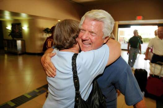 Former Super Bowl-winning coach with the Dallas Cowboys and Port Arthur native Jimmy Johnson, right, is greeted by former classmate Sue Terrell-Dartez after his arrival at the Port Arthur Holiday Inn for his 50th class reunion. Johnson is a 1961 graduate from Thomas Jefferson High School in Port Arthur.  Friday,  June 24, 2011.  Valentino Mauricio/The Enterprise Photo: Valentino Mauricio