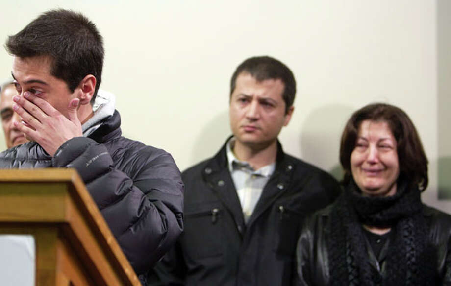 Ali Bagherzadeh, 27, left, younger brother of Gelareh Bagherzadeh, wipes tears from his eyes as he speaks to the media during a press conference next to his brother Kaveh Bagherzadeh, 38, and mother Monireh Zangeneh, 58, at Crime Stoppers offices pleading for information about her murder Wednesday, Jan. 18, 2012, in Houston.  ( Johnny Hanson / Houston Chronicle ) (Houston Chronicle)