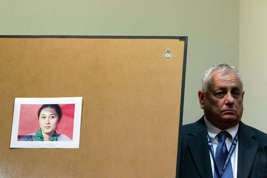 HPD senior officer Richard Bolton stands next to a picture of Gelareh Bagherzadeh, 30, during a press conference where family members plead for information about her murder at Crime Stoppers offices Wednesday, Jan. 18, 2012, in Houston.  ( Johnny Hanson / Houston Chronicle ) (Houston Chronicle)