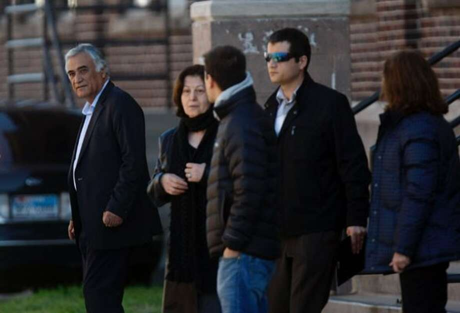 Ebrahim Bagherzadeh, 67, left, father of Gelareh Bagherzadeh walks with family members outside of Crime Stoppers offices after a press conference where the family was pleading for information into the murder of Gelareh Wednesday, Jan. 18, 2012, in Houston.  ( Johnny Hanson / Houston Chronicle ) (Houston Chronicle)